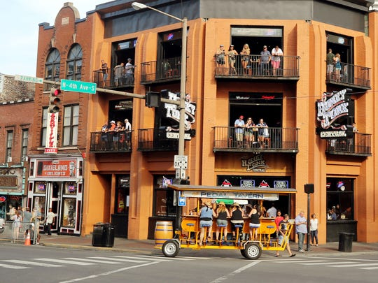 Honky Tonk Central, a multi-story bar and restaurant on Lower Broadway, faces a workplace harassment lawsuit from three women who worked at bartenders there.