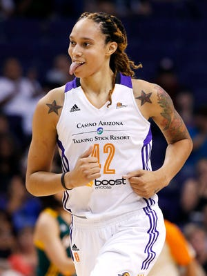 Mercury's Brittney Griner sticks her tongue out after scoring a basket against the Seattle Storm during the first half of a WNBA basketball game on Tuesday, June 3, 2014, in Phoenix.