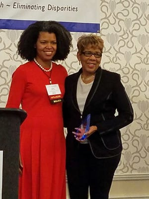 Judith Warren, right, receives the Mary Lou Anderson Lifetime Achievement Award in Healthcare Transformation from Darcey Cobbs-Lomax, executive director of Project Access New Haven and Board Treasurer of Communities Joined in Action.