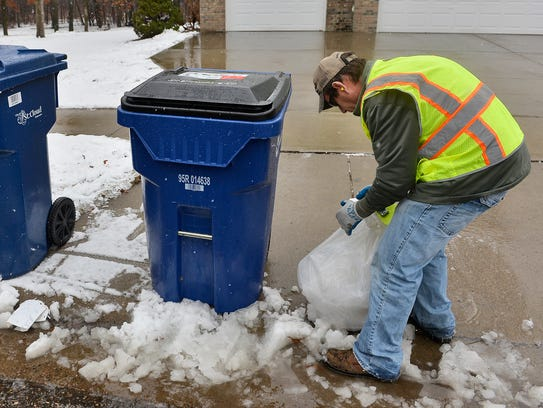 St. Cloud Public Works employee Glenn Mueller places