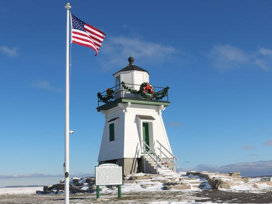 The Port Clinton Lighthouse shined as the snow fell