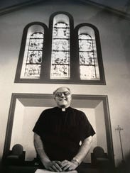 The Rev. Jonathan Wehrle poses inside St. Martha Parish