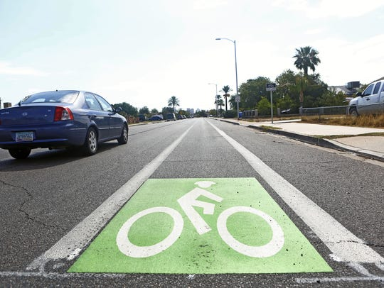 Signs mark the new bike lane on Jefferson Street in