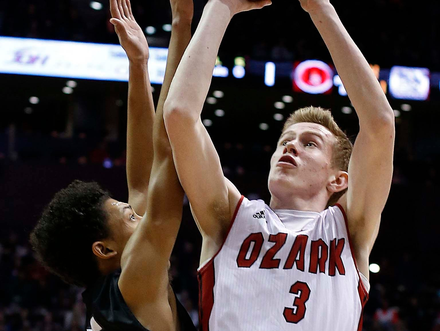 Ozark's Quinn Nelson shoots against Willard in the Gold division final at JQH Arena on December 29, 2016.