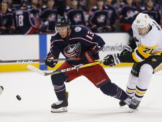 Columbus Blue Jackets' Cam Atkinson, left, and Pittsburgh Penguins' Evgeni Malkin, of Russia, fight for the puck during the third period of an NHL hockey game Thursday, April 5, 2018, in Columbus, Ohio. (AP Photo/Jay LaPrete)