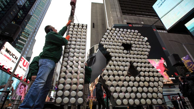 Workers unload the numerals 1 and 8 as they arrive in Times Square ahead of the New Year's Eve celebration.