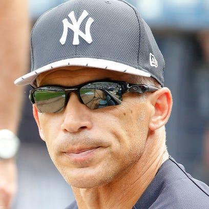 New York Yankees manager Joe Girardi (28) looks on