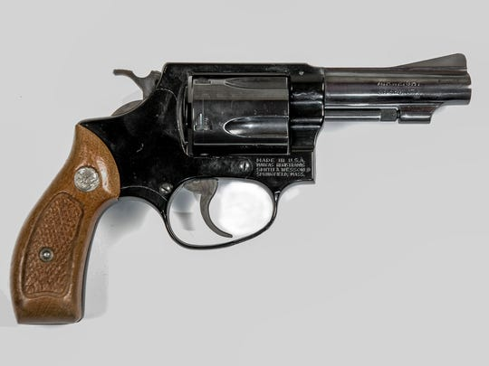 A .38-caliber revolver, similar to the gun used by Ernesto Martinez to kill Bob Martin, an Arizona police officer. Martinez's gun had distinctive black tape wrapped around the handle, and may have had a shorter barrel.