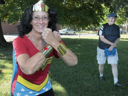 Wonder Woman, aka Rita Shacklett, director of the Linebaugh Public Library System, Saturday prepares to lead the Literacy Walk down East Main Street. Councilman Bill Shacklett assisted the superhero, his wife, in leading the walk.