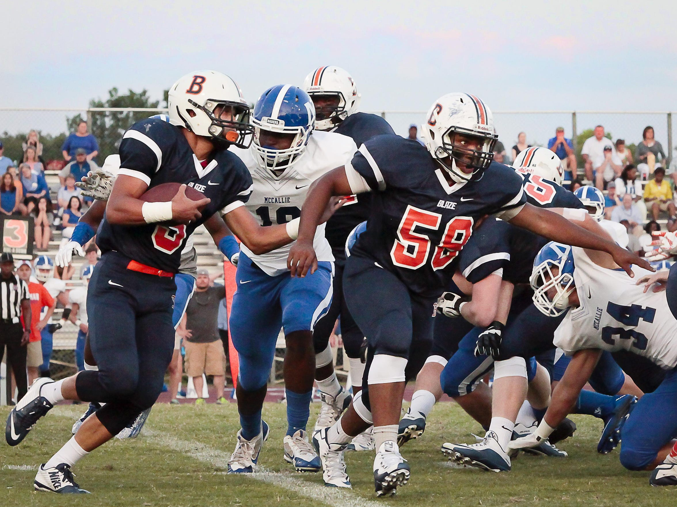 Myles Hord (58) blocks for Taeler Dowdy (3) in Blackman's