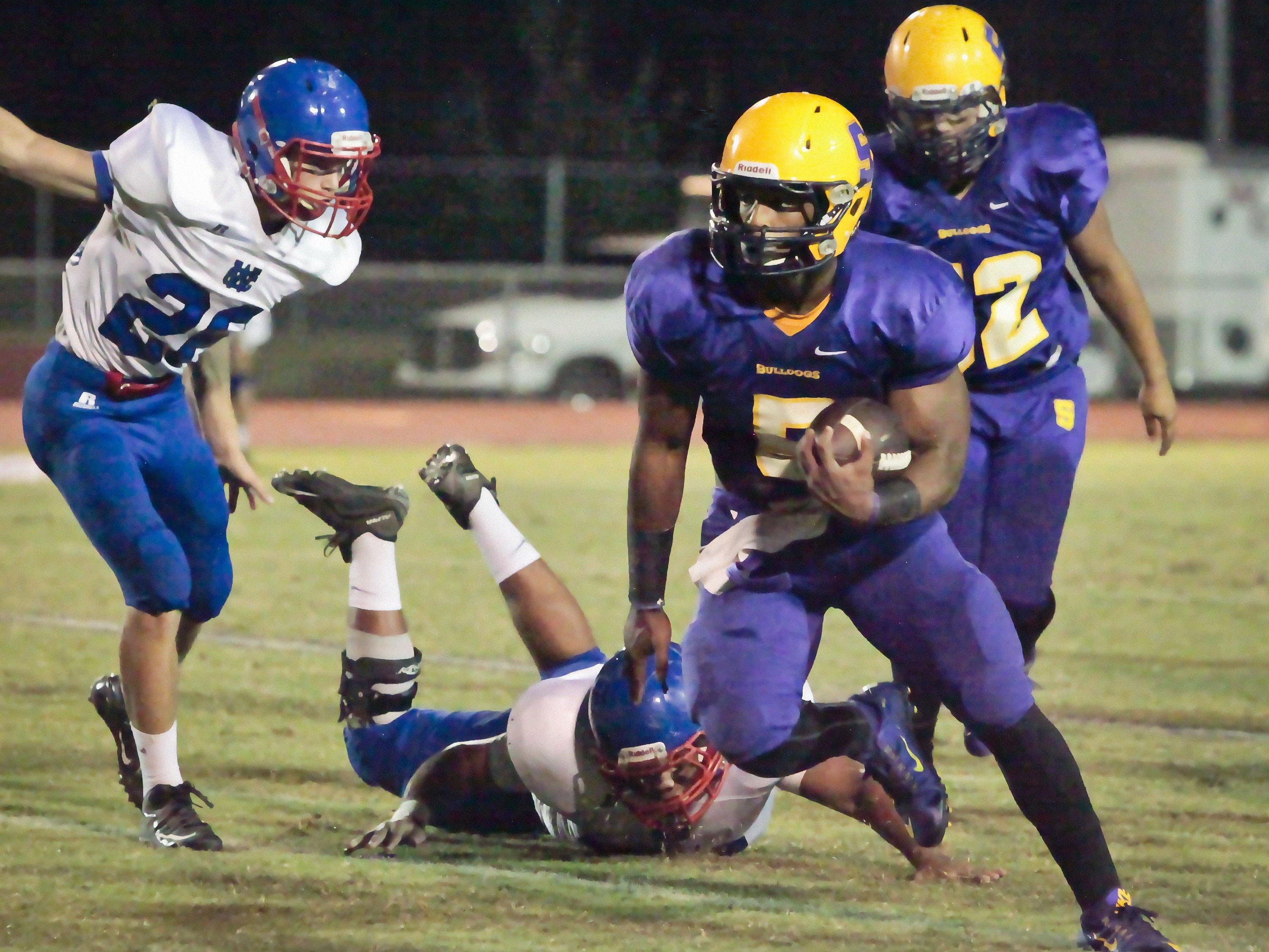 Casey Perkins (5) finds a hole and a path to the end zone.