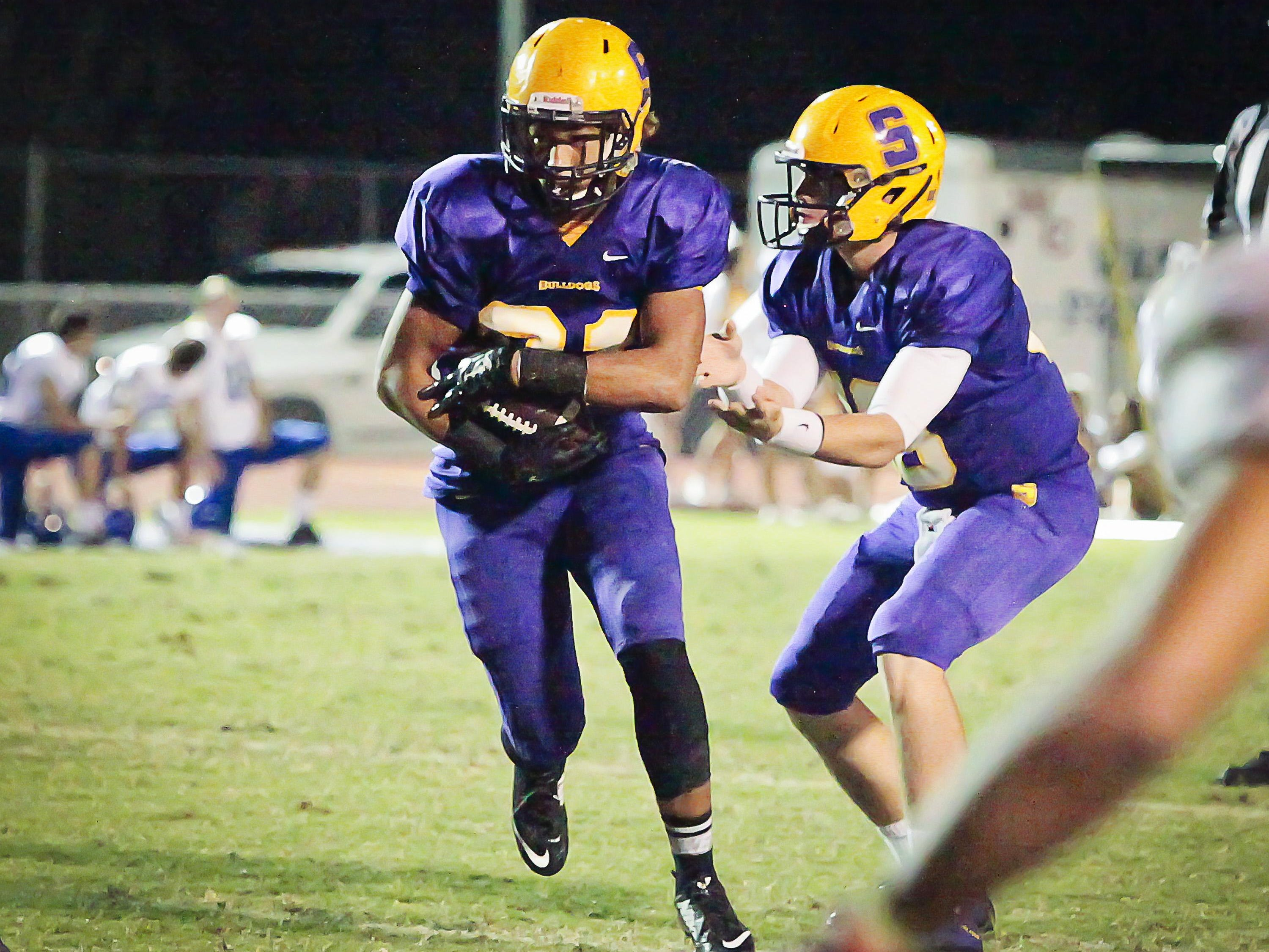 Kevin Sims, #31, takes a handoff from quarterback John Turner and runs for a touchdown.