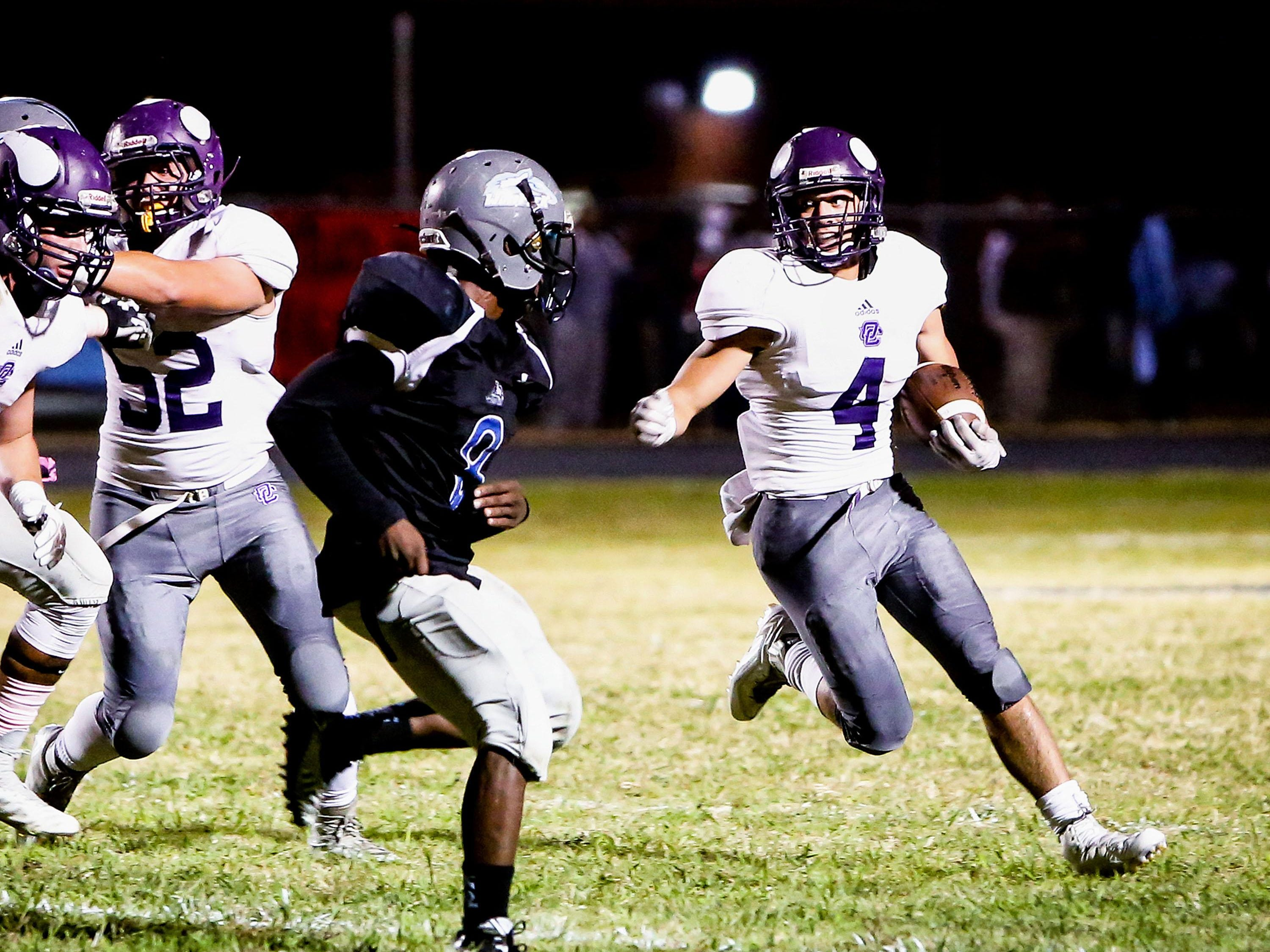 Opelousas Catholic running back Lynwood Hebert (4) tries to get outside on a sweep during win over West St. Mary.
