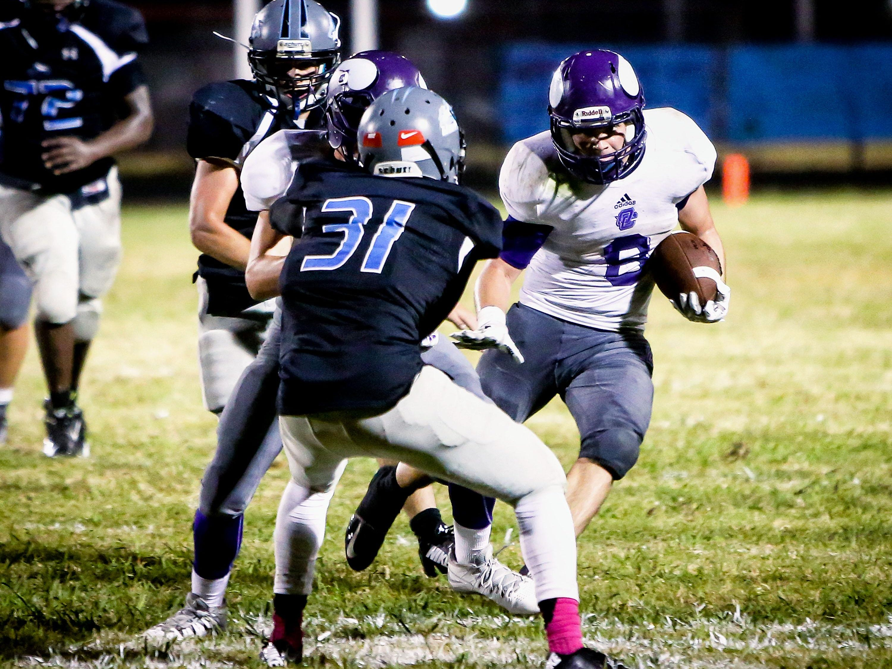 Opelousas Catholic's Aaron Miller runs for yardage during the Vikings' win over West St. Mary.