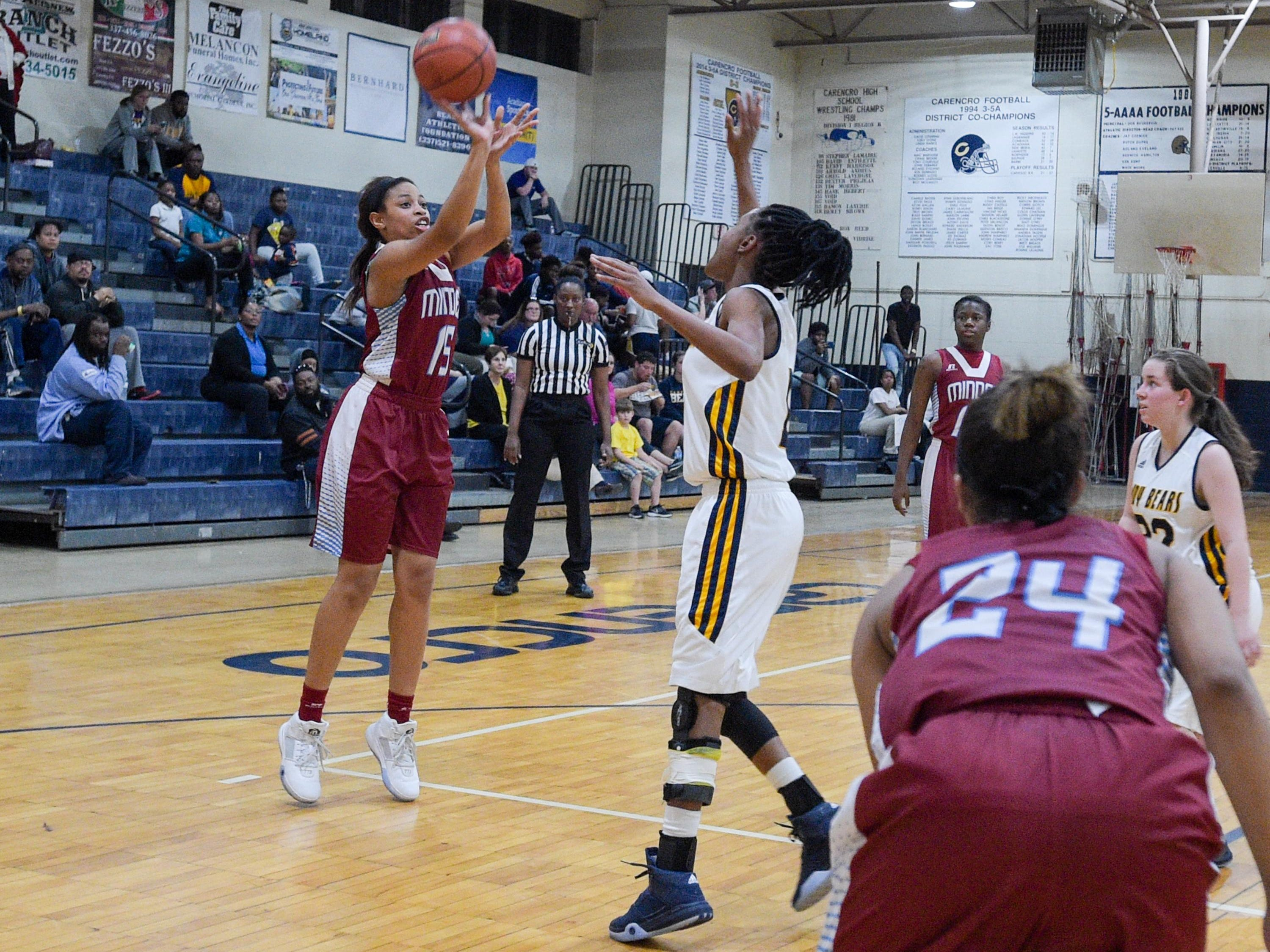 Tiaga Pugh takes a jump shot as the Minden Crimson Tide girls basketball team lost at Carencro on Thursday night.