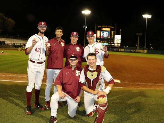 FSU pitchers Cole Sands, far right standing, Cobi Johnson, second from left and Jim Voyles combined to toss a no-hitter Wednesday. The trio is pictured with FSU pitching coach Mike Bell, center standing, and starting catcher Bryan Bussey, front left, and Cal Raleigh, who started at designated hitter and finished the game at catcher.