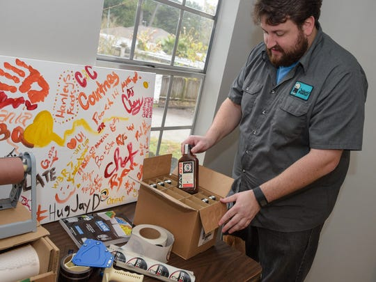 Jay Ducote has one room in his home-office dedicated to storing, packing and shipping Ducote's line of food products.