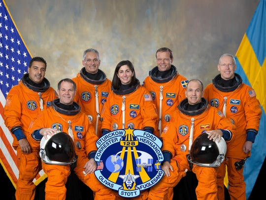 "Attired in training versions of their shuttle launch and entry suits, these seven astronauts take a break from training to pose for the STS-128 crew portrait. Seated are NASA astronauts Rick Sturckow (right), commander; and Kevin Ford, pilot. From the left (standing) are astronauts Jose Hernandez, John ""Danny"" Olivas, Nicole Stott, European Space Agency's Christer Fuglesang and Patrick Forrester, all mission specialists."