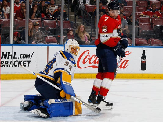 Florida Panthers center Colton Sceviour (7) looks back as St. Louis Blues goaltender Jake Allen (34) blocks his tip in attempt during the first period of an NHL hockey game, Thursday, April 6, 2017, in Sunrise, Fla. (AP Photo/Joel Auerbach)