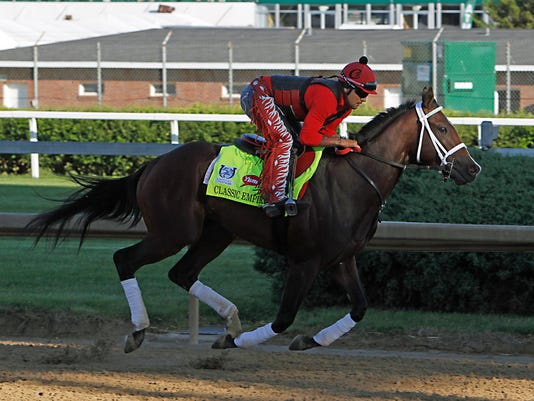 FILE - In this May 2, 2017, file photo, Classic Empire, exercise rider Martin Rivera up, gallops at Churchill Downs in Louisville, Ky.  Classic Empire is out of the Belmont Stakes because of an abscess in his right front foot. Trainer Mark Casse says the abscess found Wednesday, June 7, 2017, is a recurrence of the same problem that bothered the colt after his loss in the Holy Bull in February. Classic Empire was expected to be the favorite for Saturday's 1½-mile finale of the Triple Crown series. (AP Photo/Garry Jones, File)