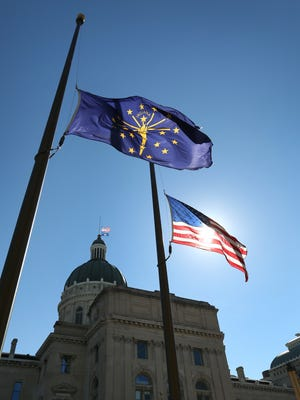 Flags fly at half-mast outside the Indiana Statehouse on October 1, 2015, for former state Rep. Bill Crawford, who served 40 years as a Democrat in the General Assembly. Crawford, of Indianapolis, who died Friday at age 79, retired in 2012.