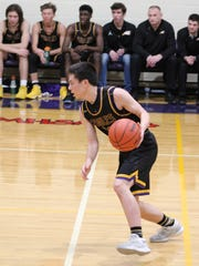 Plymouth Christian freshman point guard Nathan Etnyre dribbles up the floor Friday night. He scored 14 points in the Class D district final.