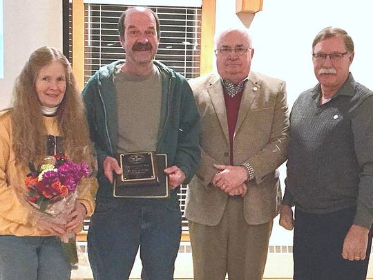 Big Flats Town Supervisor Ed Fairbrother, second from right, and Town Board member Bob Adams, right, present Betsy and Tom Gorman with the Big Flats 2017 Citizen of the Year award.