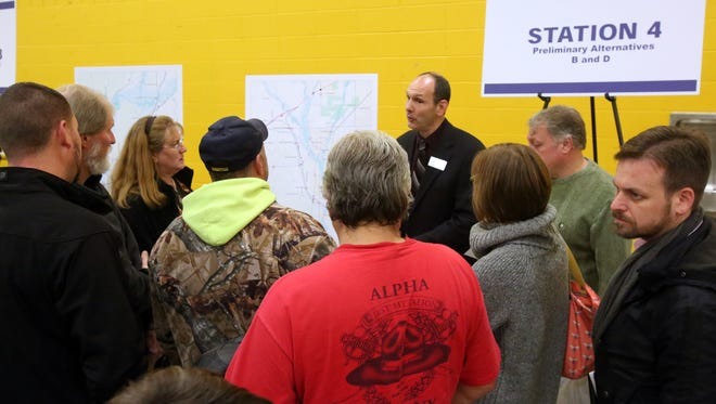 Matt Miller, with INDOT discusses the five possible routes being studied for the future I-69 extension from Martinsville to Indianapolis during an an open house session at Mooresville High School, Weednesday, Dec. 2, 2015.