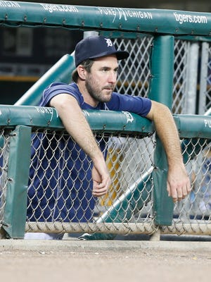 Detroit Tigers off day pitcher Justin Verlander watching from the dugout in the sixth inning during their baseball game against the Seattle Mariners in Detroit on Monday, July 20, 2015 at Comerica Park.