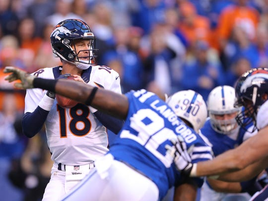 Denver Broncos quarterback Peyton Manning (18) drops back to throw during the first half of an NFL football game Sunday, Nov. 8, 2015, at Lucas Oil Stadium.