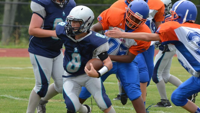 Siegel Middle's Caleb Victory (8) runs up field against Heritage during the Rutherford County Middle School Jamboree at Stewarts Creek in 2014. Victory suffered a head injury during a game in 2015 at Siegel Middle.