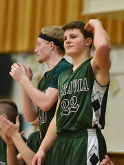Will Scaggs celebrates from the bench after a 3 point shot went in for Batavia  The Enquirer/Alex Vehr