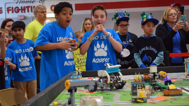 Team AMSA members Xavien Phillips and Landon Gentile from Veterans Memorial School watch as their robot moves through the obstacle course during the FIRST Lego League Tournament at Vineland High School South on Saturday.