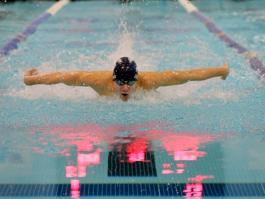 Randolph's Josh Zitomer swims the 100 butterfly during