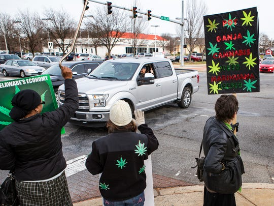 Marijuana advocates protest for legalization at the corner of Library Ave. and E. Main St. in Newark on Sunday afternoon.