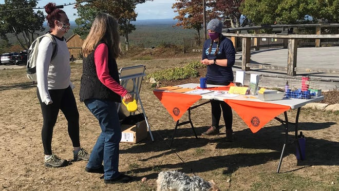"Local groups took to the trails for ""Pet Ambassador Day"" to emphasize the importance of leashing and picking up after pets on publicly accessible land preserves."