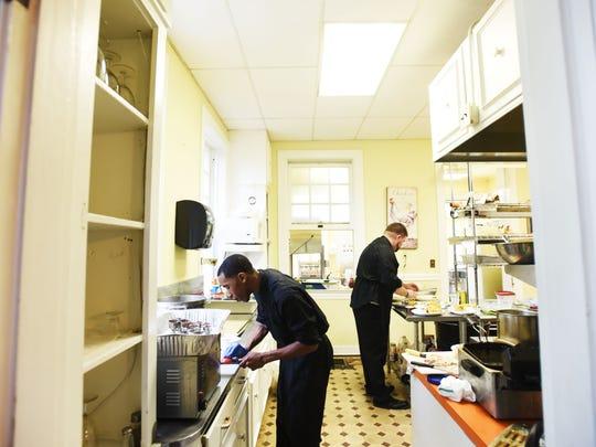 Grace Estate kitchen staff prepare dinner.