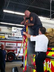 A new American flag is installed on Arlington fire