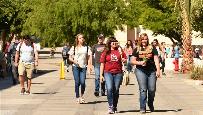 Students walk between classes on the International Mall at New Mexico State University.