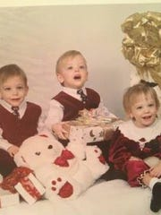 The Cromer triplets, from left, Austin, Brady and Grace.