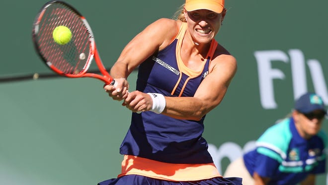 Angelique Kerber hits a shot during her loss to Sloan Stephens at the BNP Paribas Open, Friday, March 13, 2015.