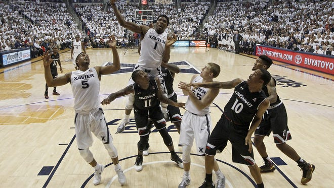 Xavier Musketeers forward Jalen Reynolds (1) pulls down a rebound in the first half of the 83rd annual Crosstown Shootout NCAA basketball game between the Xavier Musketeers and the Cincinnati Bearcats at the Cintas Center in Cincinnati Saturday, Dec. 12, 2015. At the half, Xavier led 42-26.