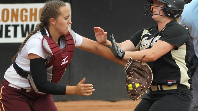 Bells' Katie Branam gets the tag out at home on Archer City's Hope Browning during a Class 2A semifinal at McCombs Field in Austin Wednesday. Archer City left the bases loaded three times in a 3-1 loss.