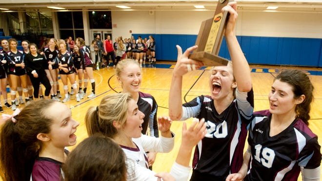 The Assumption Rockets defeated the Sacred Heart Academy Valyries 25-19, 28-16, 24-17 to win the KHSAA Region 7 volleyball championship. Here, Assumption middle blocker Kayla Kaiser holds up the trophy surrounded by her teammates.26 October 2017