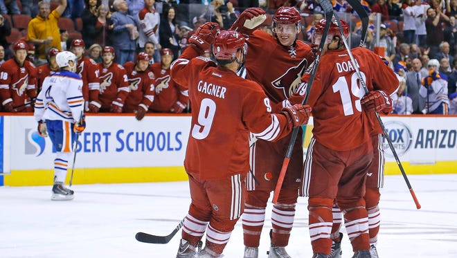 The Arizona Coyotes  greet  Connor Murphy (5) after he scored a  goal against the Edmonton Oilers during the second period of their NHL game Wednesday, Oct. 15, 2014 in Glendale, Ariz.
