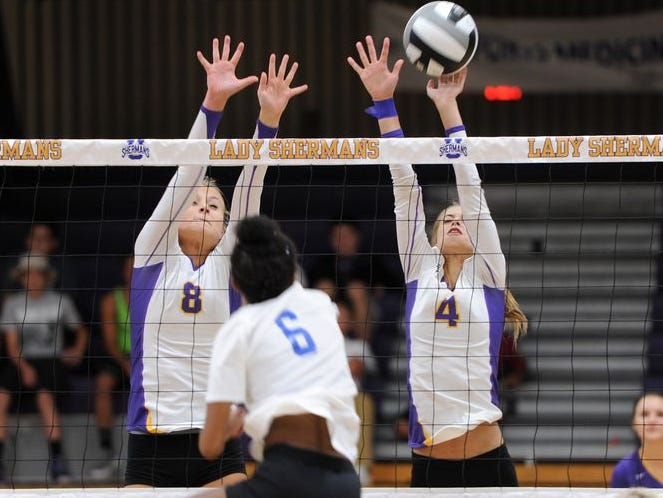 Unioto's Abbey Winegardner (4) blocks a kill attempt, earlier this season, against Chillicothe. Winegardner and her sister, Abbey, have led the Shermans to an 18-3 record this season.