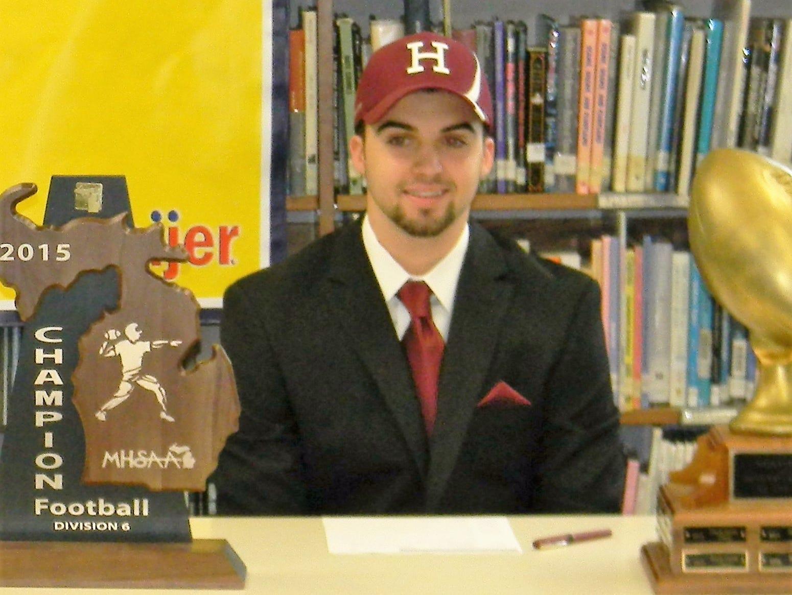 Ithaca quarterback Jake Smith signed with Harvard on Wednesday morning.