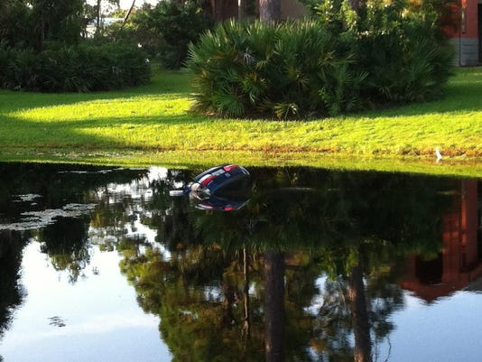 635761759988705698-car-in-pond