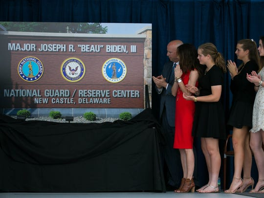 A ceremonial sign is unveiled as members of Beau BidenÕs family, including Vice President Joe Biden, and Dr. Jill Biden attend a dedication as the Delaware National Guard honor the late Beau Biden, a former Attorney General, and a Major in the Delaware Army National Guard, by naming the Delaware National Guard Headquarters, located at 250 Airport Road in New Castle, after him. The ceremony unveiled a new signage dedicating the building as the ÒMajor Joseph R. ÒBeauÓ Biden III National Guard/Reserve Center.Ó