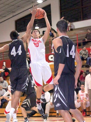 Cobre's Chris Dominguez pulls up in the paint to take this jump shot during action Tuesday night at home against Chaparral. He finished with eight points on the night.